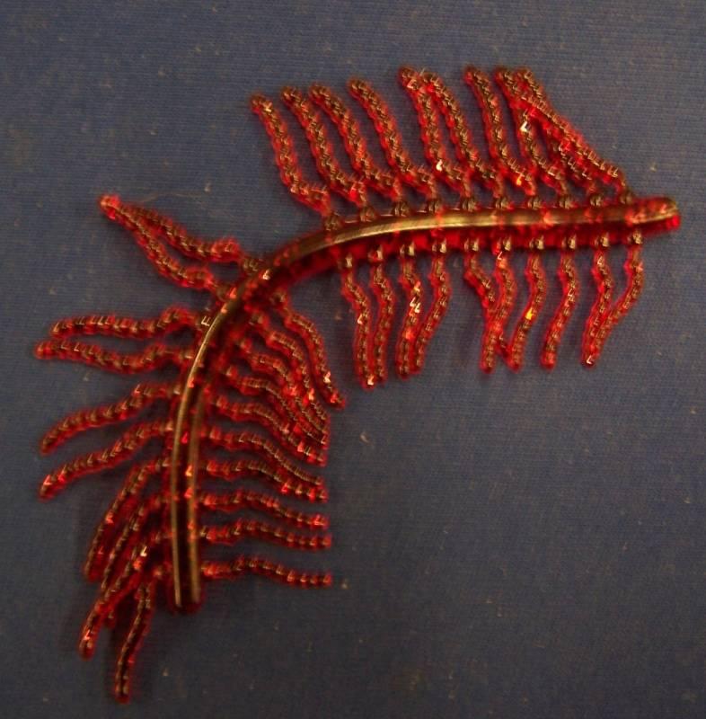 Umělá červená patentka na blistru Browning